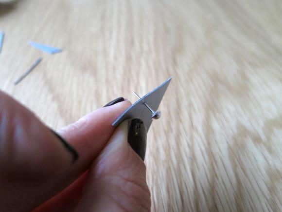 percer un triangle a l aide la boucle d oreille
