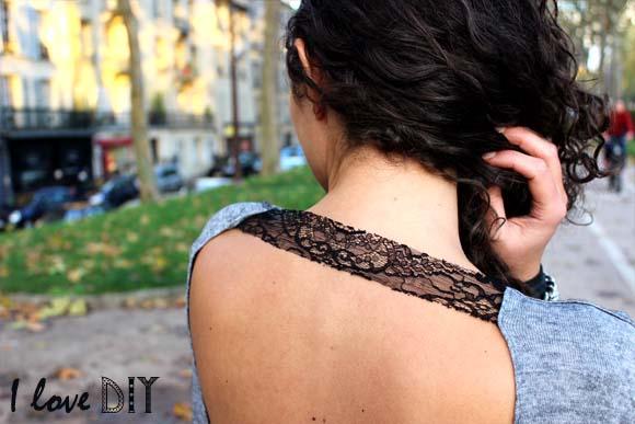 une bande de dentelle sur un pull dos  nu
